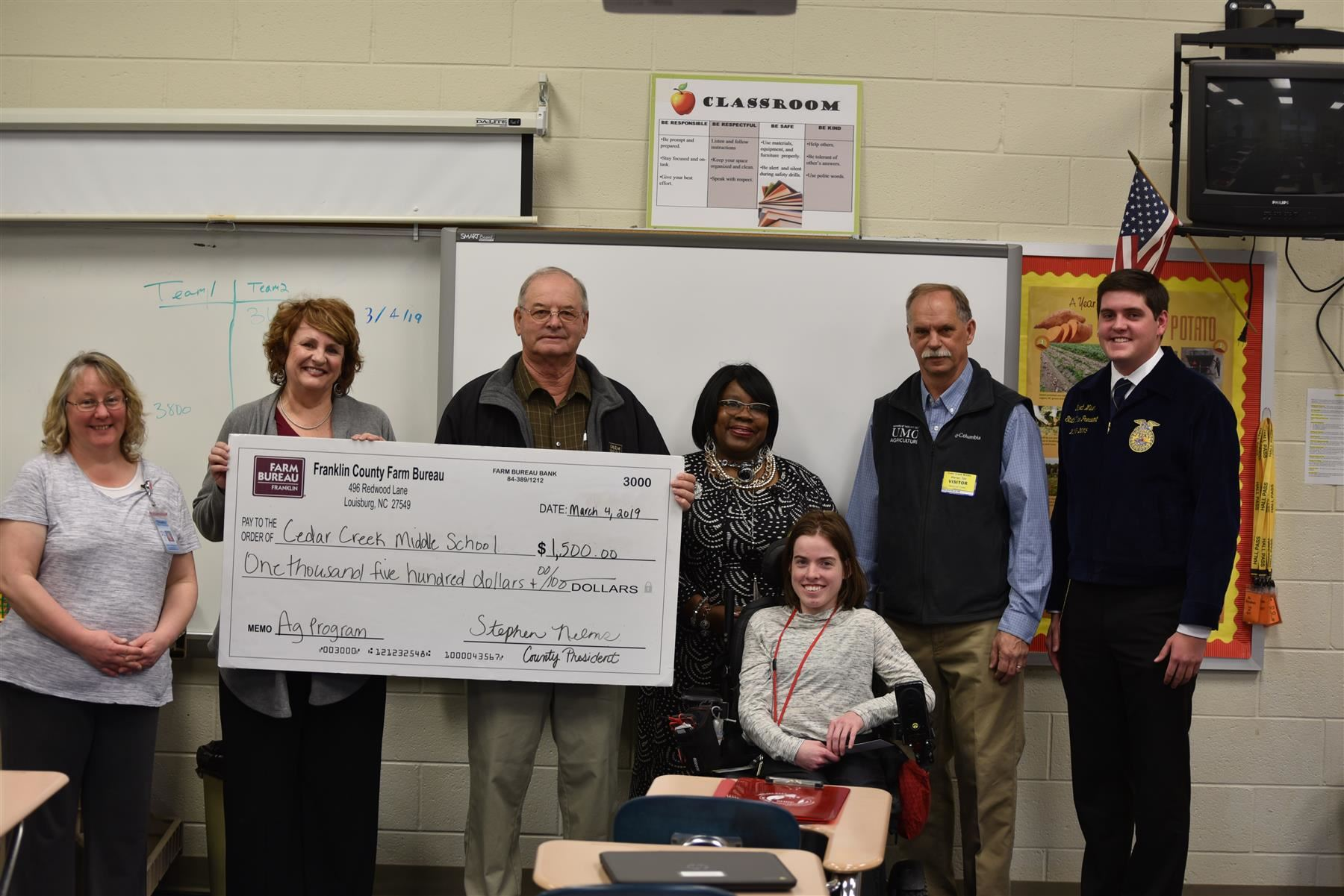 Ms. Meadows receives check from North Carolina Farm Bureau
